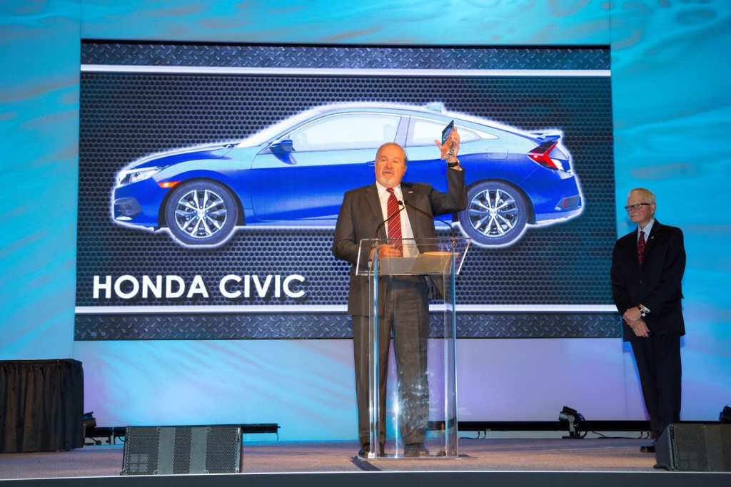 John Mendel, executive vice president of the Automobile Division of American Honda Motor Co., Inc., accepts the North American Car of the Year Award for the all-new 2016 Honda Civic.